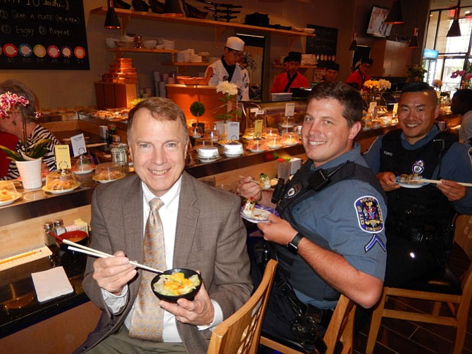 From left: Mayor David Meyer and City of Fairfax Police Officers Wade Brabble and Dale Yung enjoy lunch at KAI 10 Conveyor Sushi.