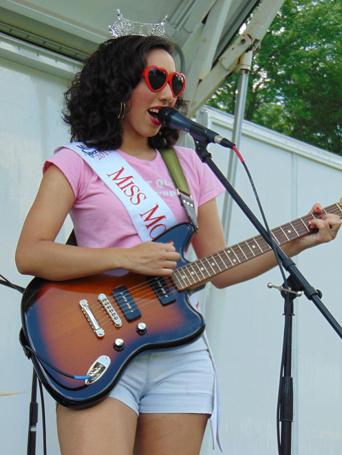 Caroline Weinroth, the lead singer of the Cinema Hearts Band, plays at the first Battle of the Bands at Lakeside Park/Royal Lake in Fairfax on Sunday, July 16.