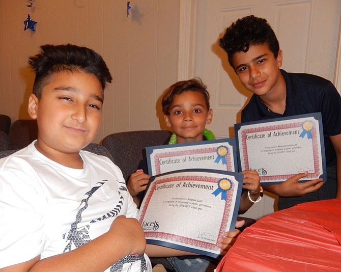 From left are three Ragan Oaks attendees, Shahid Latif, Stephen Tatem and Mohammed Froukh with their academic-achievement certificates.