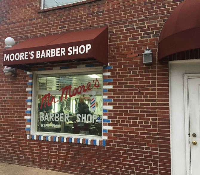 Jim Moore Jr. worked in his father's barber shop since he was seven years old. Today he owns the Arlington business founded by his father in 1960.