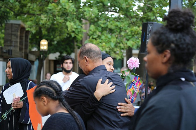 Shahed Mohamed, 15, of Reston, Nabra's close friend, embraced Mohmoud Hassanen, Nabra's father, when he arrived at the plaza for the vigil.