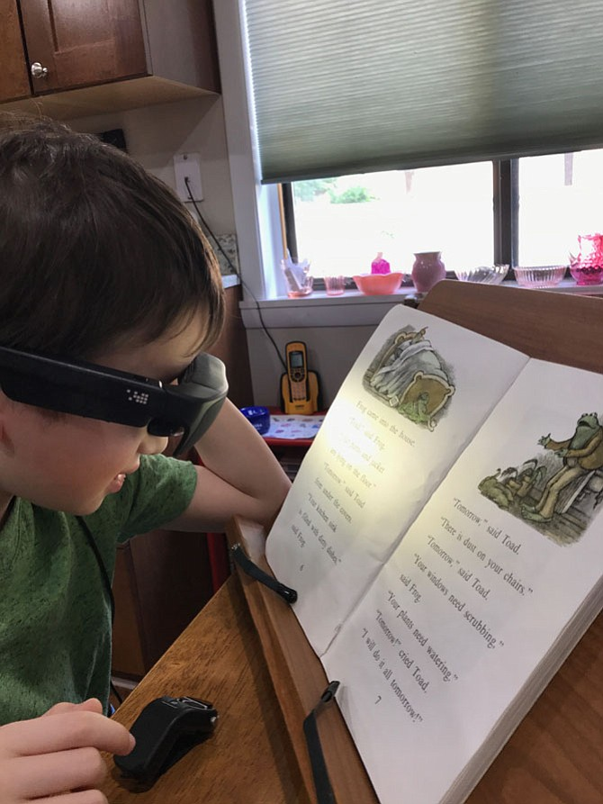 Felix Reges, 10 of Reston has a visual impairment. Regular eyeglasses do not correct or restore his vision, but with the magnification and freedom capacity of his NuEyes visual prosthetics, he can see to read and navigate at home and in school.