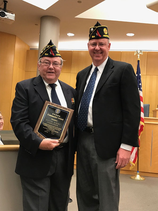 David R. Womack, newly installed Commander Herndon/Reston American Legion Wayne M. Kidwell, Post 184 congratulates David Kirby, Past Commander, as Kirby accepts the Commander Award in recognition of his loyalty, dedicated service and leadership as he served as Commander from 2006-2017.