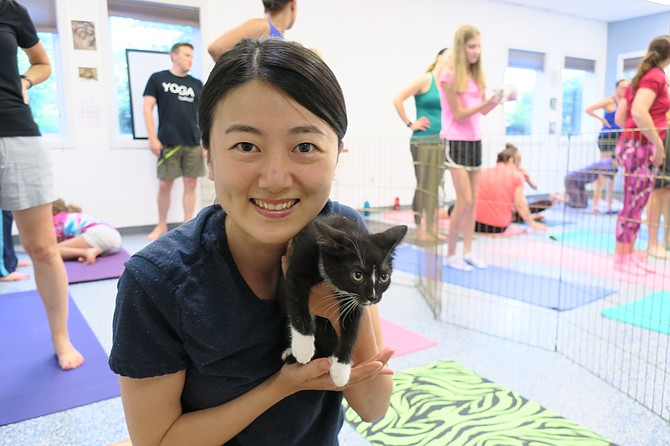 Shoko Tanno, who was visiting the area, came to kitten yoga to relax and enjoy interacting with the kittens.