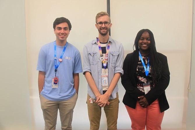 Teen Services Coordinator Isaiah West (center) with summer interns Josh Habib (left) and Divine Tsasa Nzita.