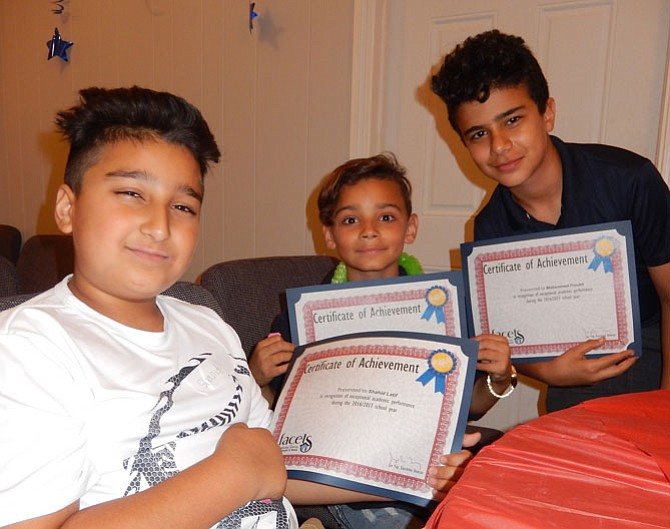 From left: Three Ragan Oaks attendees, Shahid Latif, Stephen Tatem and Mohammed Froukh with their academic-achievement certificates.