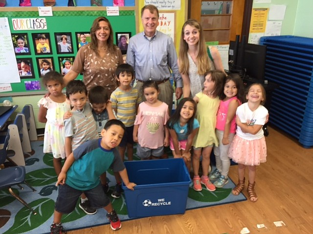 """Mayor David Meyer visited Main Street Child Development Center, Fairfax, on July 18 with a handful of letters and a stack of brand new recycle bins. The letters were from the """"Dolphins"""" Pre-K class, expressing the need for recycling pick up at their preschool, located at the Green Acres Community Center. The Mayor thanked the children for taking care of their community and the environment and congratulated each for an early and successful start in exercising their rights as citizens."""