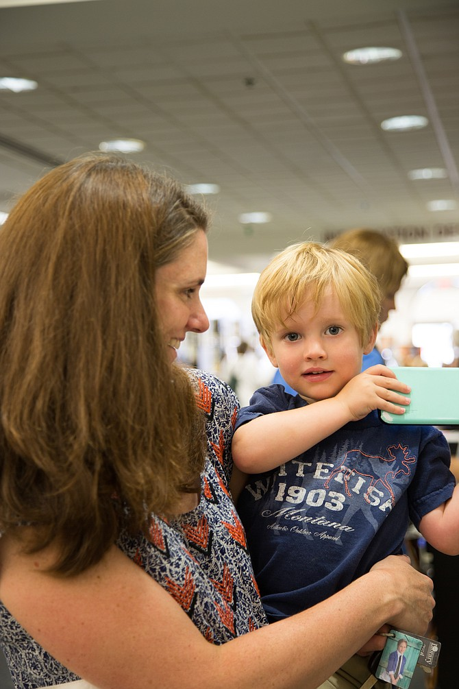 """Kelly Richardson was at the Patrick Henry Library with her son, Neil, 2. """"The summer reading program really motivates my daughter,"""" said Richardson. """"My son doesn't care; he likes to read. But my daughter likes the coupon book as a reward."""""""