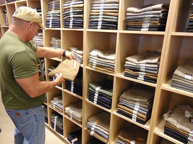 A 5.11 store customer inspects Ridgeline pants.