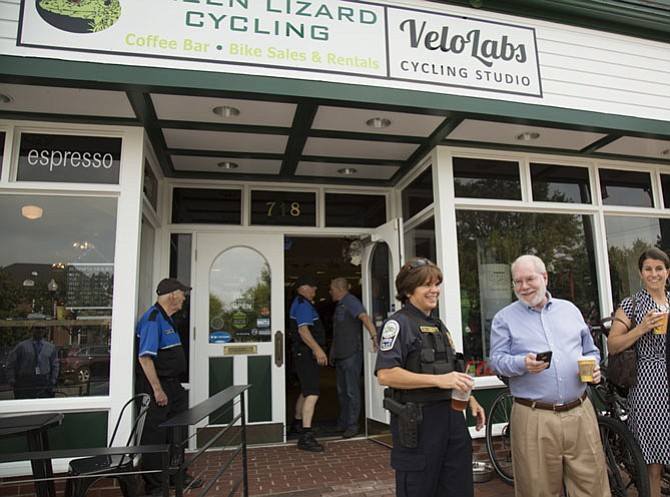"Herndon Police Chief Maggie DeBoard speaks to people outside of Green Lizard Cycling during a ""Coffee with a Cop"" event on Thursday morning, July 27."