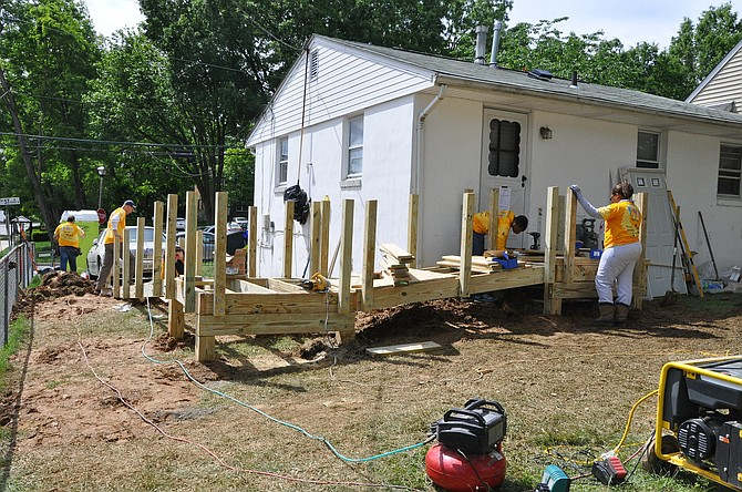 Volunteers install a ramp to Sam Avery's front door and made other repairs that improved the safety of his home.