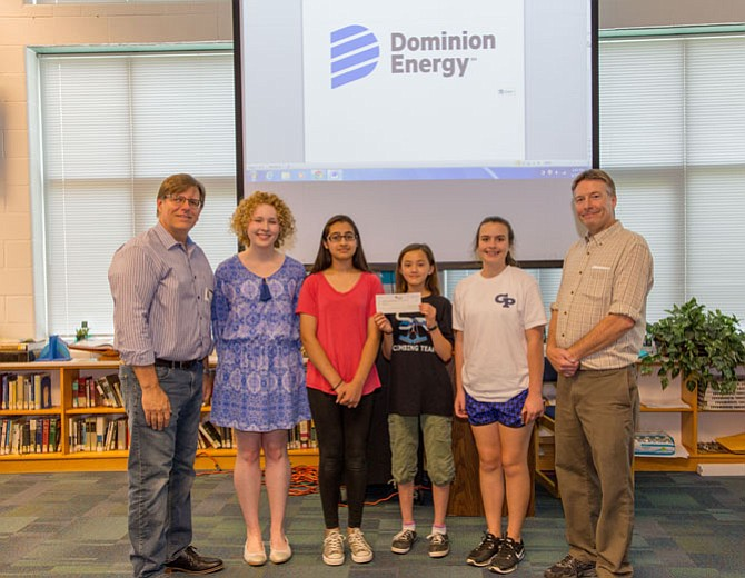 Students from Fairfax County's Rachel Carson Middle School, the winning team in the Earth Force 2016-17 environment competition, hold the $5,000 financial gift that the Dominion Energy Charitable Foundation awarded to support Earth Force's 2017-18 competition. Vince Meldrum (far left), president & CEO of Earth Force, poses with Hayley Snowden (second from left), a representative from Dominion Energy's Media Relations team, and the students' teacher (far right).