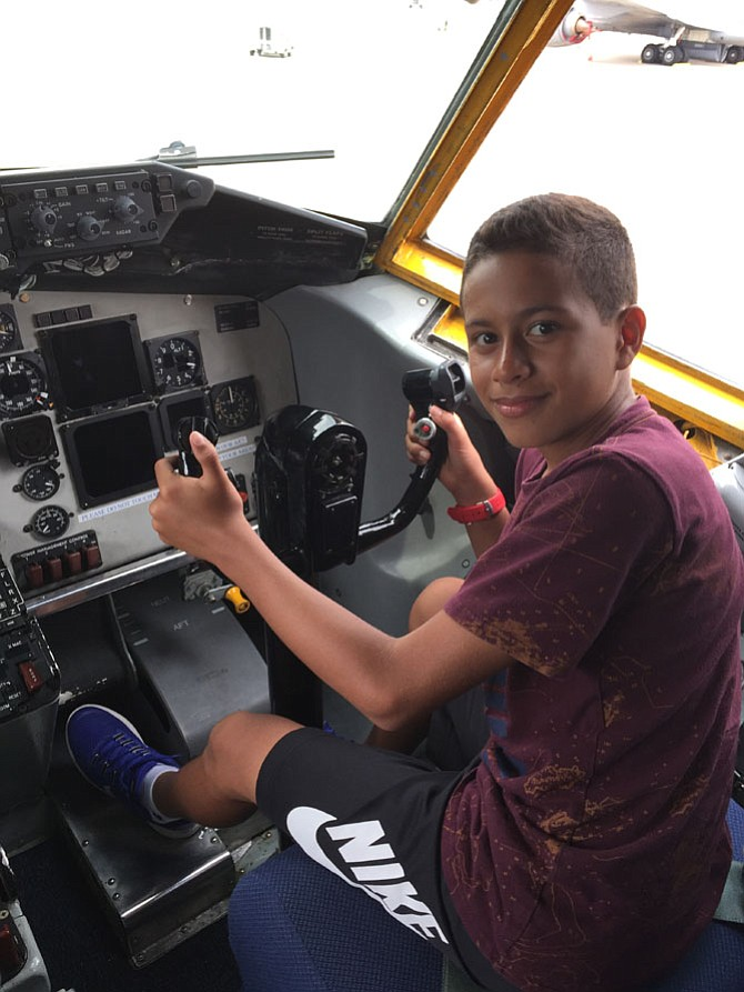 Santiago in a plane at Andrews Air Force Base where Eddie Miller used to fly planes.