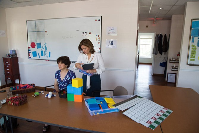 Mina Azari Kondner, director and Nahid Momenian, teacher at Mina's School of Great Falls, display math teaching props that they use to help tutor children in math who may be struggling in public school.