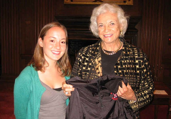 "Morgan Findley, Herndon High School Class of 2008, kept this photograph of herself and Justice Sandra Day O'Connor, the first woman to serve on the Supreme Court of the United States. The photo was taken on a field trip Findley took part in as a student in Douglas Graney's political science class. ""I will always be indebted and grateful [to him],"" Findley writes to the Connection. Graney cites in his book that since he had met Justice O'Connor before this meeting, he was hoping she'd give him a big hello like they were BFFs, so the kids would be impressed. Instead, her first sentence was, ""So, what do you kids want to talk about?"""