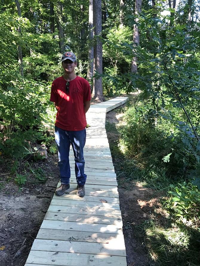 Life Scout Daniel Wozniak on the boardwalk in Gil McCutcheon Park.