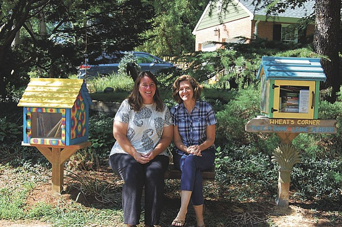 Liz Schroeder, left, and neighbor Eleanor Whitaker, at Liz's library duplex in Riverside Gardens.