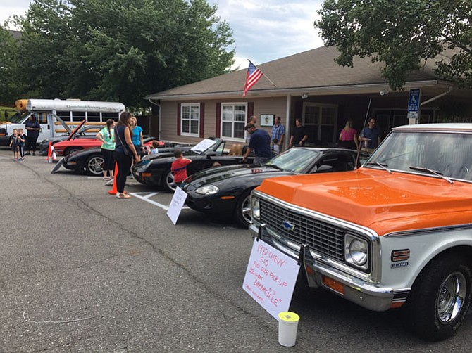 Students at Chesterbrook Academy Preschool Fair Lakes hosted a Father's Day car show to raise funds for St. Jude Children's Research Hospital.