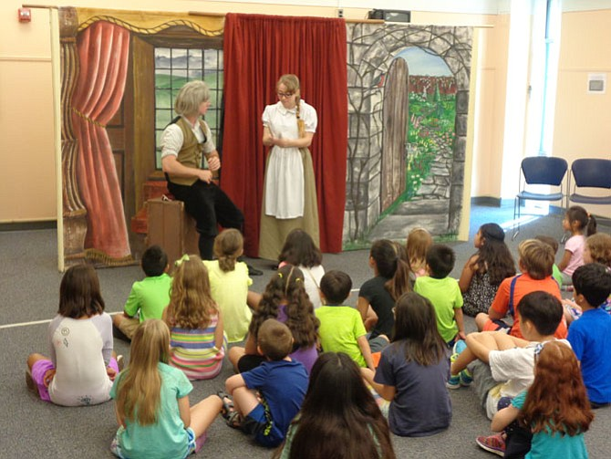"Hampstead Stage actors Ian Emerson (left) and Katie Marsh (right) performed ""Beauty and the Beast"" at Kings Park Library on Tuesday morning."