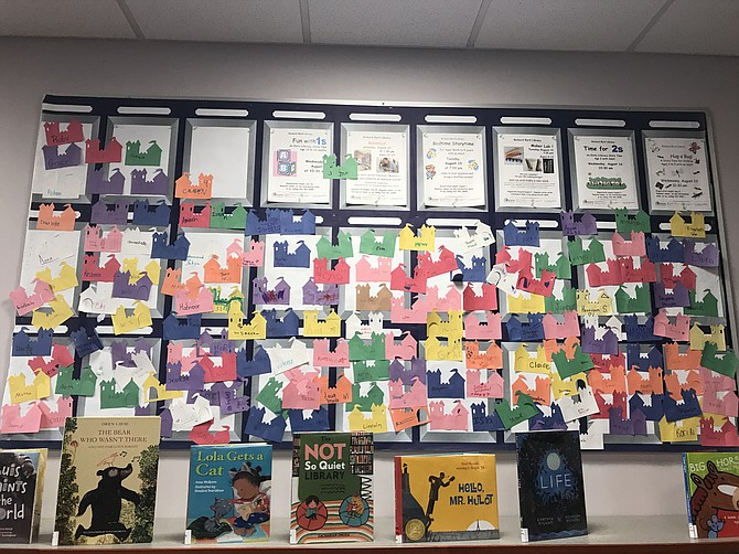 A colorful wall of children's names brightens up the library.