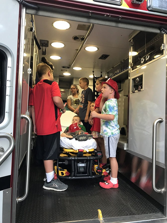 Children get to see the inside of an ambulance.