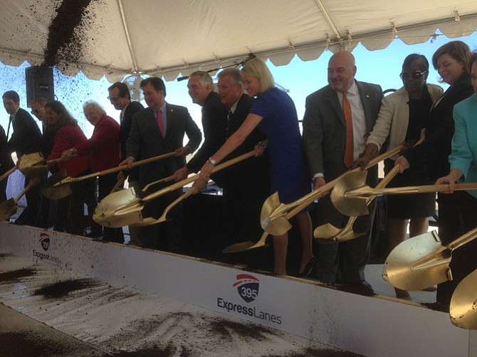 State transportation officials get out the golden shovels to kick the 395 Express Lanes project off.