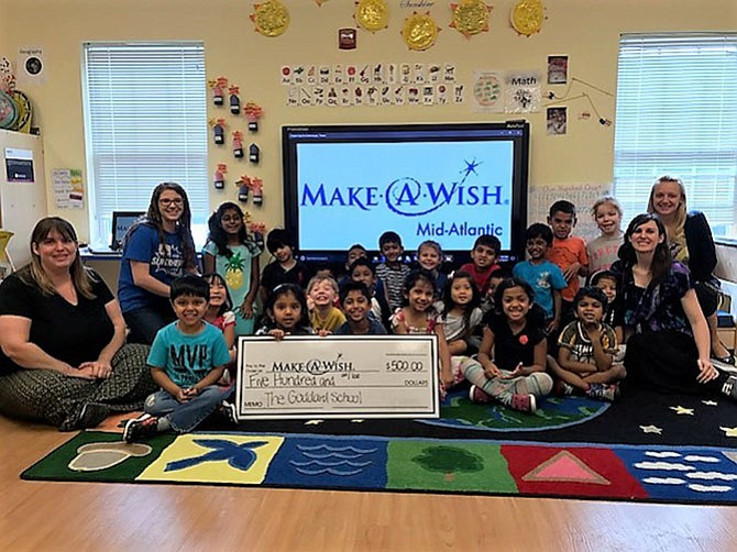 Kari Hartbauer of Make-A-Wish Foundation visits The Goddard School in Herndon acknowledging the children's effort of raising $500 for this cause.