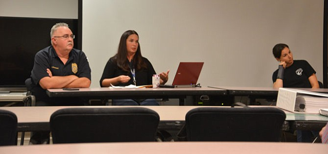 From left: Sgt. Earit Powell of the Fairfax County Police Dept. manages the deer hunting operations. Katherine Edwards, Ph.D. is the county's wildlife management specialist. Together with Kristen Sinclair, ecologist III, Natural Resources Branch, the three hosted the public meeting on the 2017-2018 Deer Population Management Program.