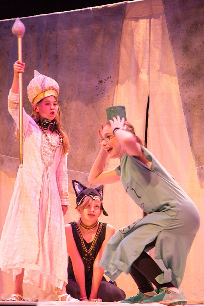 "Niono played by Paige Merten, Claire Daly, playing the part of Bastet, and Thoth, played by Chloe Flye perform in The Traveling Players production of ""Atum's Eye,"" set in ancient Egypt at The Madeira School in McLean."