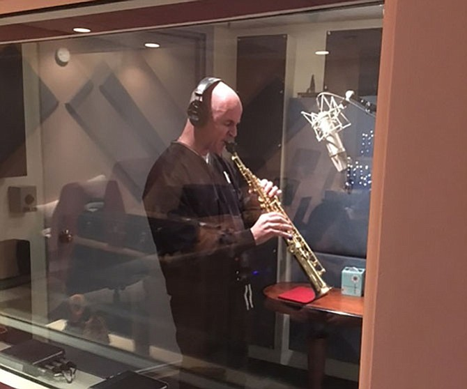 Fr. Keith O'Hare playing the saxophone during a recording session at Hobo Audio Co. studios in New York City.