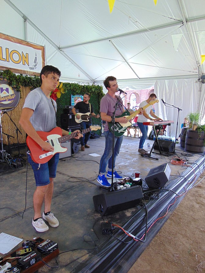 The band Virginia Man with lead singer Kristian Lietzan of Fredericksburg, Va., performs under the Pubvilion Tent.