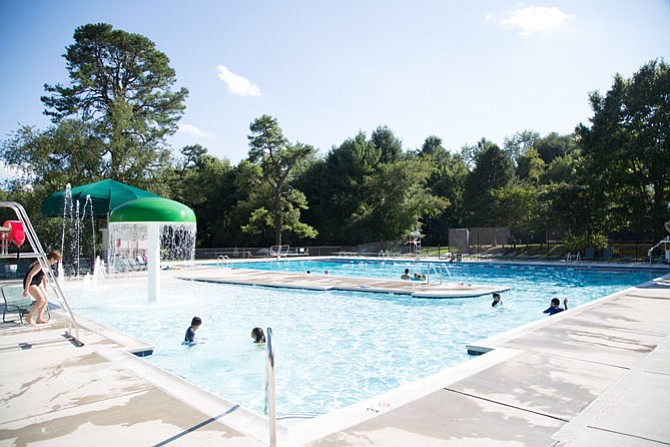 A wide shot of the Burke Centre Ponds Pool in Burke Tuesday, Aug. 8. This pool has zero-foot entrances  — a convenience for babies and toddlers to learn how to swim.