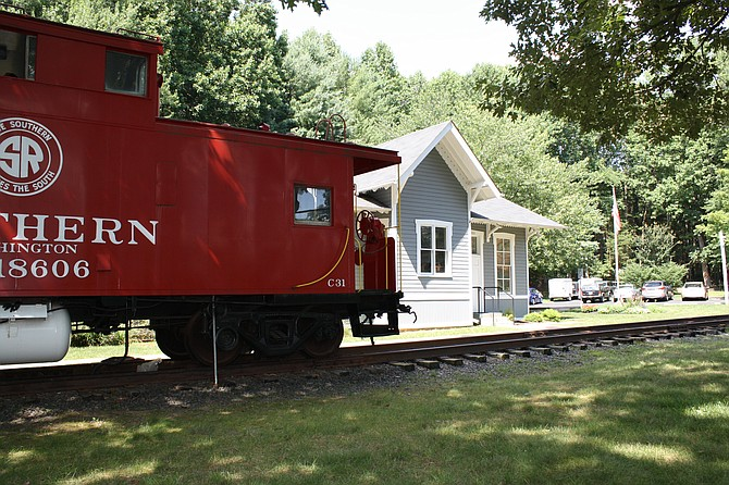A red caboose is a center of attraction at the Fairfax Station Train Depot.