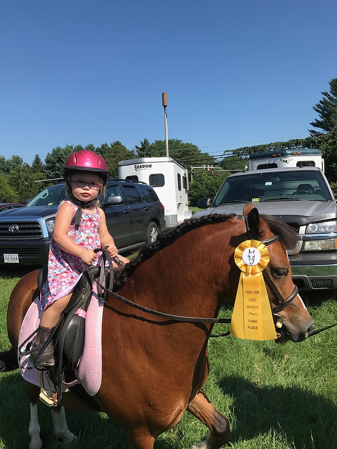 Frankie Schofield 2, of Round Hill shows off her sister Ryleigh's pony at Turner Farm Events' Summer Horse Trials, Combined Test, and Dressage Show held Sunday, Aug. 20 at The Turner Farm.
