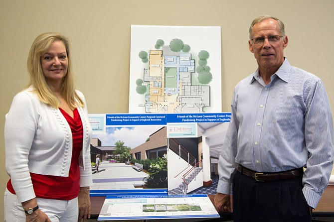 From left: Robin Walker, Social Media Editor for McLean Community Center, and George Sachs, Executive Director, pose next to plans for the renovation of the McLean Community Center Wednesday, Aug. 16.