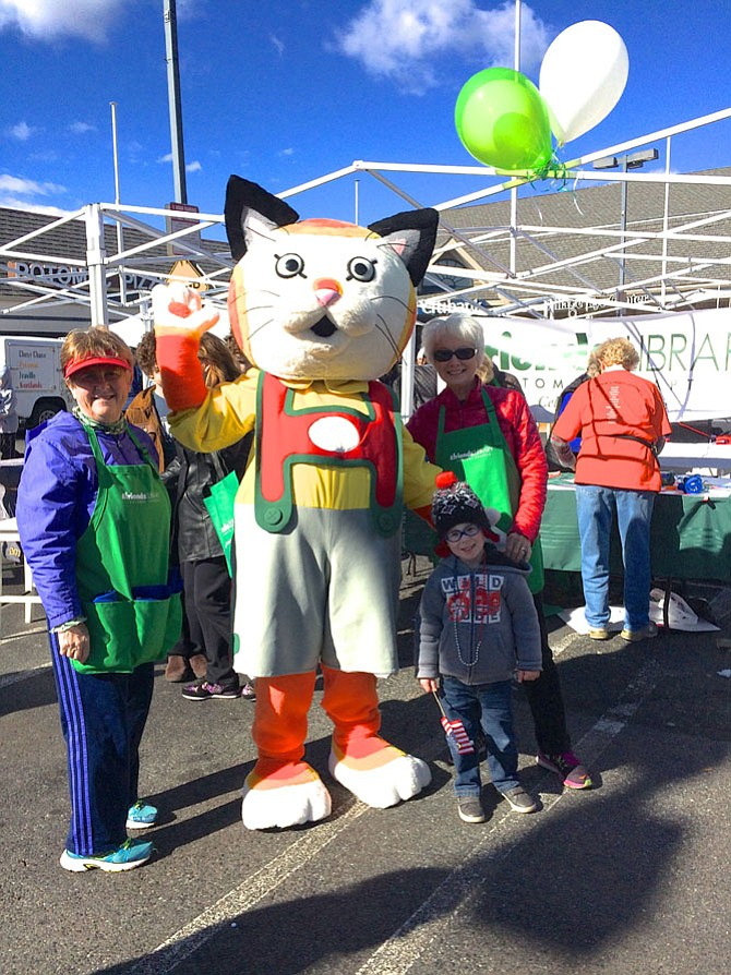 Huckle Cat with Marty Johnson and Edie Wingate from Friends of the Library along with 3-year-old Domini Whitney at last year's Potomac Day celebration.