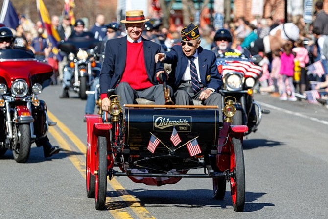 Alexandria is home to several signature events, including the George Washington Birthday Parade. This year World War II veteran Col. Kim Ching, right, waved to the crowd from Bob Geier's 1903 Curved Dash Oldsmobile as the parade made its way through the streets of Old Town.