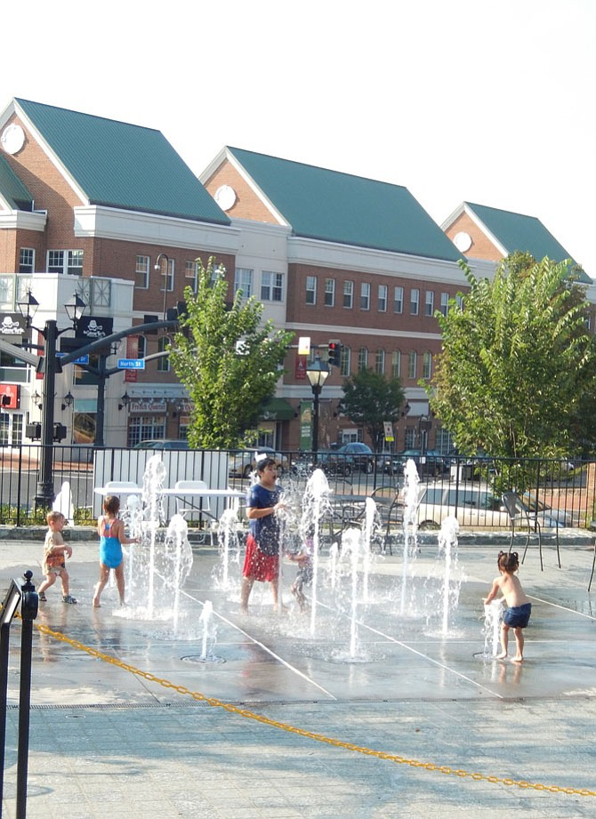 Children enjoying the splash pad in Fairfax City's Old Town Square.