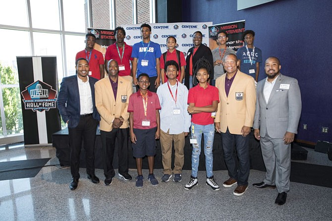 Keynote Speakers/Pro Football Hall of Famers Darrell Green (front row-second from left) and Aeneas Williams (front row-second from right) with 100 Black Men of Greater Washington, D.C. mentors Travis Reed and James Thompson and students.
