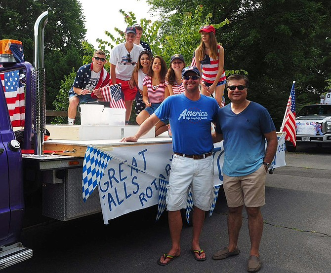 The current president of Great Falls Rotary Vishal Chawla and current vice president Butch Sevila pictured with the Club's float at the Fourth of July celebration in Great Falls.