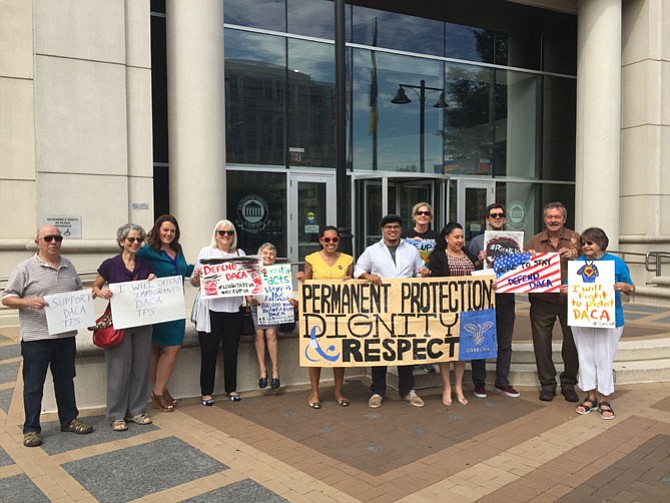 Activists rally outside Arlington County offices.