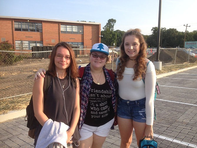 "Hannah Friend, left, with fellow West Springfield seniors Rowah Teskeq, and Cheyenne Jones are heading to ""Sparta,"" a temporary set of classrooms, on the first day of school."