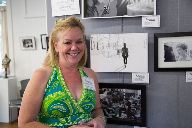 Laura Goyer, a Vienna Resident, and a photographer herself, was a judge for the show at the Vienna Arts Society on Saturday, Aug. 19. Here she stands next to some of her own work which was separate from the show.
