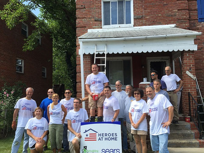 Rebuilding Together Alexandria volunteers gather at one of the houses repaired through a Sears' Heroes at Home grant.