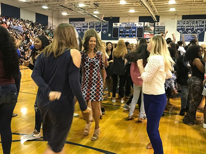 English Teachers Janna DeCoster (center) and Kelly Fontana (right) join in the fun at the back-to-school pep rally by showing off their moves and sharing a laugh.