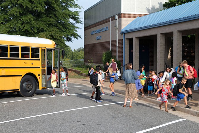 Lees Corner Elementary School bustles as students arrive in front of the school on Monday, Aug. 28.