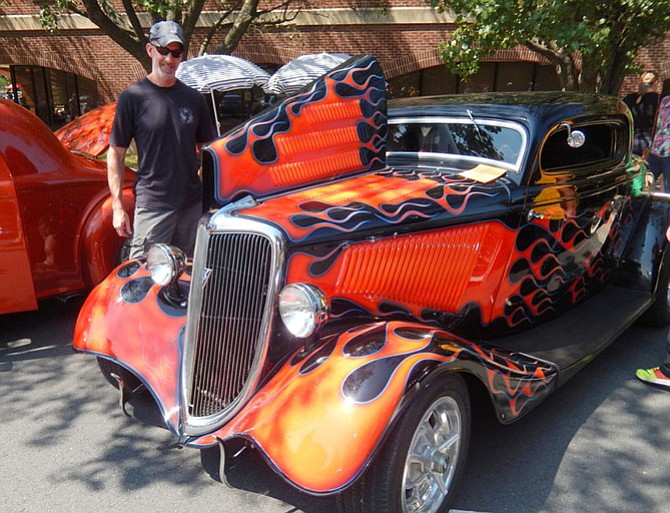 Glen Wright checks out this spiffy, 1934 Ford at the 2016 Labor Day Car Show in Fairfax.