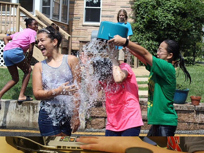 Campers take a break from the heat with a friendly water war.