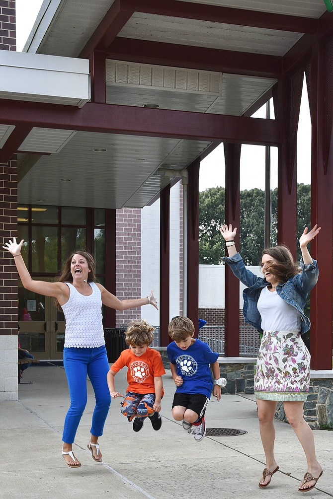 Carderock Springs Elementary School teachers Lauren Day and Juliet McDonald with students Levi and Asher Zeitlin on the first day of school, Tuesday, Sept. 5.