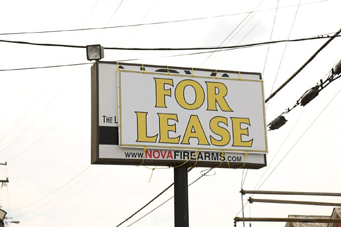 "A ""For Lease"" sign has been placed over a sign at its former retail location, which bordered the Franklin Sherman Elementary School, after NOVA Firearms announced it was relocating to retail space at 412 W. Broad Street in Falls Church."